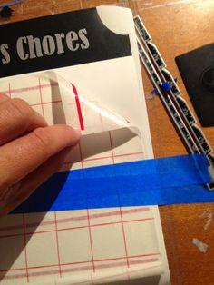 Peeling transfer paper from vinyl design