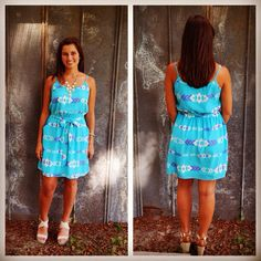 This tribal belted dress costs $41 at Penelope's Boutique!