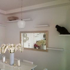 The placement of the floating white shelves creates a perfect climbing area for cats without being an eyesore. The shelves almost disappear. Who says you can't accommodate your cat's need to climb while stillmaintainingyour sense of style? Nicely done.