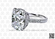 Antique cushion cut diamond engagement ring by Leon Mege