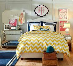 I love the bright yellow and coral colour scheme going on in this bedroom. awesome!