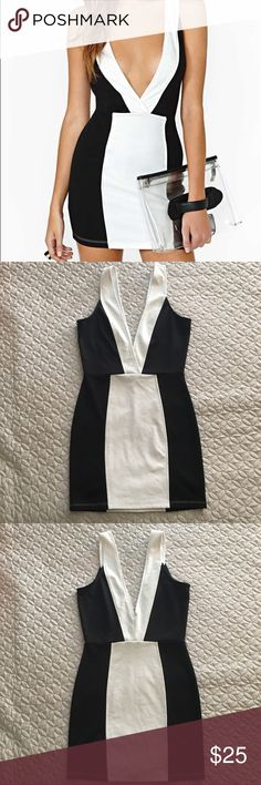 Nasty Gal Bond Girl Dress | Deep V-Neck Nasty Gal Bond Girl Dress Size Small. Black and white bodycon deep v-neck dress. Good condition with no snags or stains. Great for clubbing or a night out! Nasty Gal Dresses