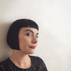 short dark blunt bob haircut with blunt bangs