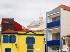 Brightly painted houses are part of the experience in the fishing town of Aveiro, Portugal