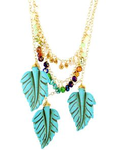 """Navajo Feather Necklace  The necklace Pocahontas would die for  Gold plate necklace with 3 cascading layers. one with 3 feather shaped hematite stones, the others with gradient faceted crystals 18""""    More From Rory Ashton Jewelry"""