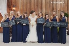 Each bridesmaids sign says how they met the bride. Love this idea!