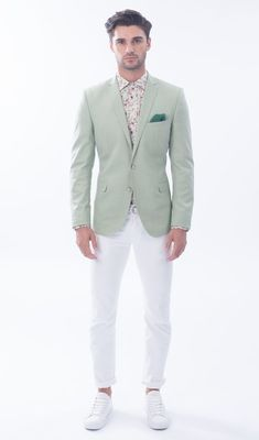 Something as simple as teaming a mint coat with white chinos can potentially set you apart from the crowd. Opt for a pair of white low top sneakers for a more relaxed feel. Shop this look on Lookastic: https://lookastic.com/men/looks/blazer-dress-shirt-chinos/20002 — White Floral Dress Shirt — Green Pocket Square — Mint Blazer — White Chinos — White Low Top Sneakers