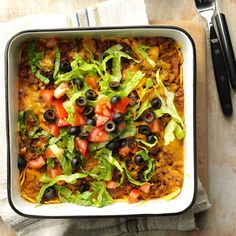Taco Salad Casserole Recipe -This casserole tastes like a taco salad and is a breeze to assemble. I crush tortilla chips to form a bottom layer, then spread on refried beans, a spicy meat mixture and cheese. —Rhonda McKee, Greensburg, Kansas