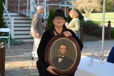Leslie Crews holding a portrait of Abraham Lincoln at the Appraisal Fair (April 2014).