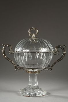 A Jam pot in Baccarat crystal and silver.