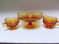 Here is the Cambridge Glass, Tally Ho patterned, golden amber Comport with sugar and creamer set.  This elegant glass comport measures 4 inches tall  offered by #rubylane shop Saltymaggie's Treasures