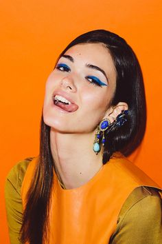 We Dare You To Ditch One Earring    Mango Long Sleeve Shirt, $49.99, not yet available online; Ben-Amun by Isaac Manevitz Turquoise and Lapis Statement Earrings, $270 and $38, not yet available online.