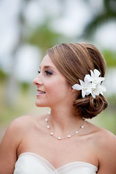 Side-swept do | Photography by Joanna Tano Photography, Bridal Gown by Watters, Bride's Hair & Makeup by Beautiful Maui Brides by Marci