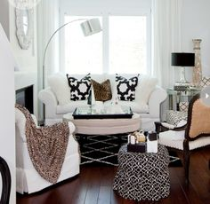 White with lovely mix of pattern.  The 3 unmatched chairs and stool are spectacularly blended.  Not your typical matchy matchy. Via the decorista