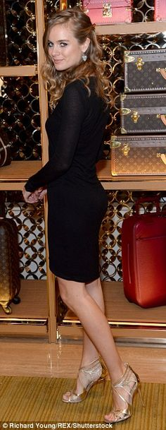 Out and about: Cressida Bonas was elegant in an asymmetric LBD and gold caged heels...