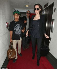 Close: Angelina with Maddox earlier this year; she has said her oldest son is the most sim...