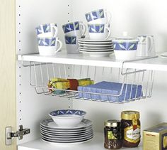 Simply hook the storage basket on to the shelf compartment.Additional storage space for serviettes, kitchen roll.Can also be used in the wardrobe for the storage of small items or socks.Made of chrome with anti slip rubb Under Shelf Basket, Basket Shelves, Storage Baskets, Storage Spaces, Clutter Organization, Kitchen Organization, Kitchen Arrangement, Ideas 2017, Cupboard Shelves