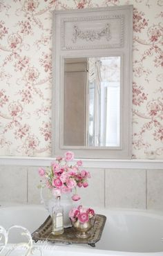 Love the whole look....the vintage mirror, the toile wallpaper and white paneling below.