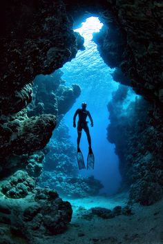 Diver in front of a cave in the Ras Mohammed National Park, Egypt - #diving #underwater