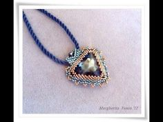 Tutorial: DIY Videotutorial how to bezel a triangle swarovski of 23 mm with delica and seed beads.