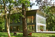 The Montfort residence is the model for the French designer's second series of made-to-order houses produced in partnership with Riko, one of the leading European manufacturers of prefabricated wooden buildings. PATH homes by Philippe Starck and Riko