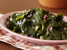 Collard Greens recipe from Paula Deen via Food Network Note: pay attention to the Ingredient list. Only use 1 tablespoon of house seasoning - not a cup of salt (which would be to make a large batch of house seasoning for future use). Paula Deen Collard Greens, Southern Style Collard Greens, Collard Greens Recipe, Paula Deen Greens Recipe, Food Network Recipes, Cooking Recipes, Healthy Recipes, Cajun Cooking, Easy Recipes