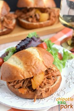 Slow Cooker Chipotle BBQ Pork recipe: delicious tangy pork with sweet peaches on a pretzel bun!