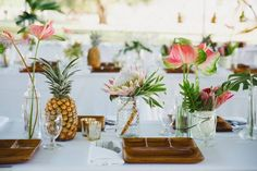 24 Summer Wedding Ideas to Copy for Your Own Celebration - Check out these steal-worthy summer wedding ideas, themes, and tips before you start planning your warm weather soirée. table decor white glass flowers tropical beach pineapple {Mira Mira Events} Tropical Wedding Reception, Bohemian Wedding Theme, Wedding Summer, Rainbow Wedding, Green Wedding, Wedding Centerpieces, Wedding Decorations, Wedding Favors, Wedding Invitations