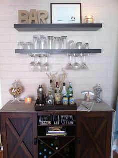 I need to create a sideboard in our giant dining room, this looks lovely. Verona buffet, Ikea lack shelves w/ wine glass storage underneath.---For above the buffet. Wine Glass Storage, Interior, Ikea Lack Shelves, Dining Room Bar, Home Decor, Bars For Home, Mini Bar, Glass Storage, Home Bar Decor