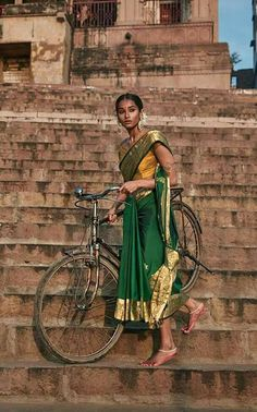 Image may contain: 1 person, standing, bicycle and outdoor india индия.