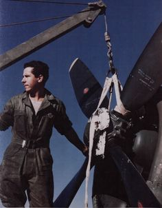 A Member Of The First Brazilian Fighter Squadron Removes The Propeller Of A P-47 At An Airfield Somewhere In Italy