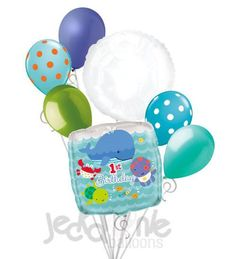 """Included in this bouquet: 7 Balloons Total 1 – 18"""" """"1st Birthday"""" Under the Sea Square Balloon 1 – 18"""" White Round Balloon 5 - 12"""" Mixed Latex Balloons (Periwinkle, Orange Polka Dots on Caribbean Blue"""