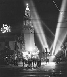 Although Grauman's Chinese Theatre got the lion's share of glamorous Hollywood movie premieres, it's hard to beat the Fox Carthay Circle Theatre for spectacular photos like this one taken in 1941. That soaring tower with the beacon on top, those searchlights raking the night sky, the long shadows cast by the waiting parking valets, and the big neon sign with the circle visible for miles—I bet the atmosphere on nights like these was thrilling.
