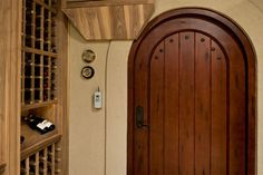 Custom Wine Cellar - Wooden, traditional Tuscan 42in wide wine cellar entrance system Pleasant Ln., Glenview, Glenview Haus Photo Gallery, Chicago