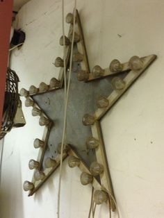 star - looks like it has light bulbs on it...actually a wooden star frame, with drawer pulls around the perimeter.