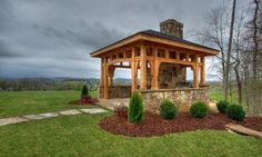 timber frame pavilion with fireplace and wood fired pizza oven