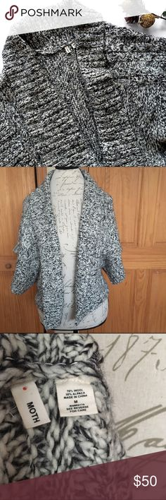 """Anthropologie Moth Marled Poncho Sleeve Cardigan Gorgeous black & white marled poncho sleeve cardigan by Moth from Anthropologie! Short Poncho sleeves are super wide. This is so cozy and will look great with a long sleeve tee or even a tank! Approx. 20.5"""" L from shoulder to hem. 70% wool, 30% alpaca. Excellent pre-loved condition!   🚫no trades 🚫no modeling ✅dog friendly/🚭smoke free home ✅reasonable offers ✅bundle & save! Anthropologie Sweaters Cardigans"""