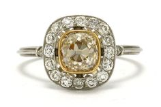 The Rancho Palos Verdes Edwardian Engagement Ring. An intriguing antique yellow diamond engagement ring, centered by a juicy old mine cut cushion of a mesmerizing yellowish orangey champagne and quite large at 1.32 carats. #diamond #engagementring #love #ido #engaged #edwardian #edwardianring #edwardianrings #platinum #cushiondiamond #oldminediamond #yellowdiamond #champagnediamond Yellow Diamond Engagement Ring, Estate Engagement Ring, Antique Engagement Rings, Cushion Diamond, Halo Diamond, Edwardian Ring, Rare Gems, Champagne Diamond, Jewelry Stores