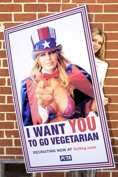 "Playboy Playmate Kimberly Hefner poses with a poster for the Ethical Treatment of Animals ad campaign November 16, 2001 in Culver City, CA. The campaign introduces Hefner in a scanty Uncle Sam costume with the message ""I want YOU to go vegetarian""."
