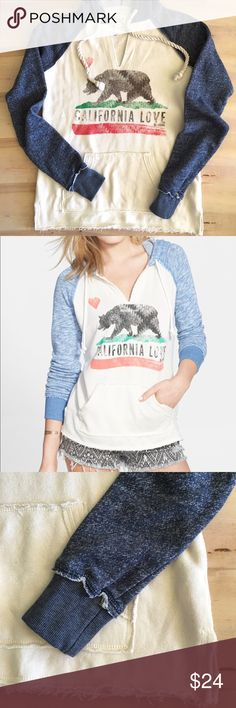 """Billabong French Terry Hoodie / Sweatshirt Show off your California love with a two-tone hoodie cut from soft French terry. Frayed edges and a faded graphic lend casual, carefree style. Super comfy!! Great condition *2nd pic has lighter blue sleeves posted for style reference- cover photo are true colors.  26"""" length  Kangaroo pocket 60% cotton, 40% polyester Billabong Tops Sweatshirts & Hoodies"""