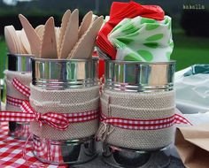 Large cans decorated for utensils