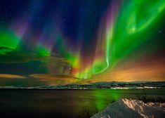 Aurora near Tromso Norway, seen over the Bo Fjord by Wayne Pinkston.  Taken on February 15, 2015 https://www.flickr.com/photos/pinks2000/16549850470/