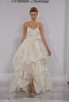 Stunning corset top and ruffling dress by Pnina Tornai.