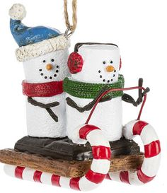 Super cute couple on a sled S'mores Original ornament. 2 1/2'' W. x 2 3/4'' H. Item SM177109.