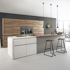 Wood, white and grey make a stunning combination in this modern open plan kitchen
