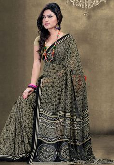 Add an extra dose of style and #glamour to your daily ethnic wear with this Black-Cream Color Georgette #DesignerSaree which is accompanied with a matching Blouse Piece. The saree is adorned with interesting prints and distictive border.