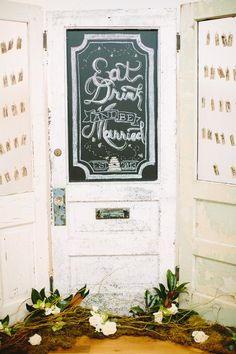DIY Vintage Doors with Chalkboard Sign and Escort Cards | See the wedding on #SMP -  http://www.StyleMePretty.com/2014/01/10/the-cotton-room-wedding/ Julia Wade Photography