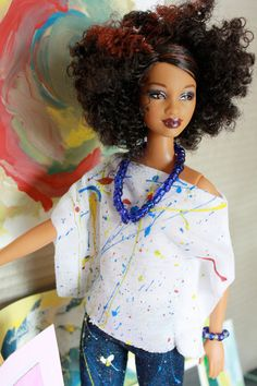 She is creating master pieces in her own rugged artistic style. In this fashion doll art themed package there is:1 artsy white top  1 artsy skinny jeans1 tote bag  1 blue beaded stretch necklace  1 blue beaded stretch bracelet  1 piece of artwork, 1 set of doll sized colored pencils  This cute little outfit is splashed with acrylic craft paint. It is easy to slide the pants up the hips and the shirt carefully over the head and up stretched arms of a fashion doll like Barbie,