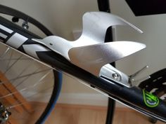 The Bird and (and it's sister The Owl) are beautiful versions of a standard bike bottle cage