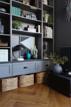 Ikea's Billy bookcase gets the ultimate hack treatment, when four units are transformed into a dark, sophisticated wall-hung display/storage unit. hacks living room wall units Ikea Billy Bookcase Hacks - How To Make the Cult Item Look Built-In Living Room Built Ins, Living Room Wall Units, Living Room Storage, Living Room Designs, Living Rooms, Ikea Billy Bookcase Hack, Bookcase Wall, Billy Bookcases, Ikea Billy Hack